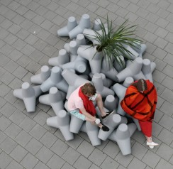 Miniaturised coastal defense block stacked as a climbing island on a schoolyard