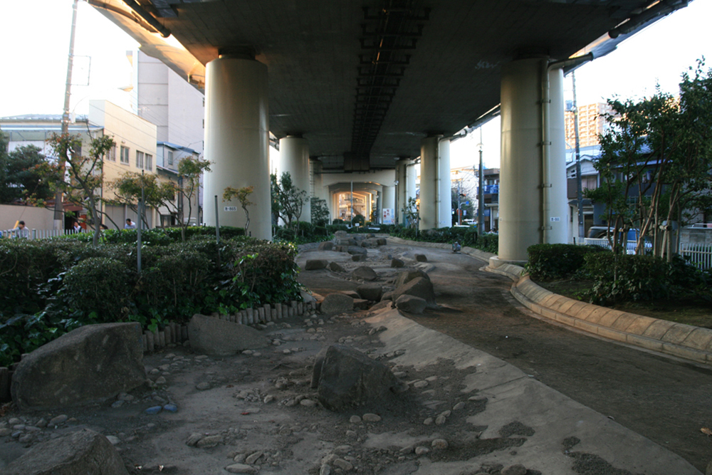 Artificial riverbed underneath the Tokyo Expressway
