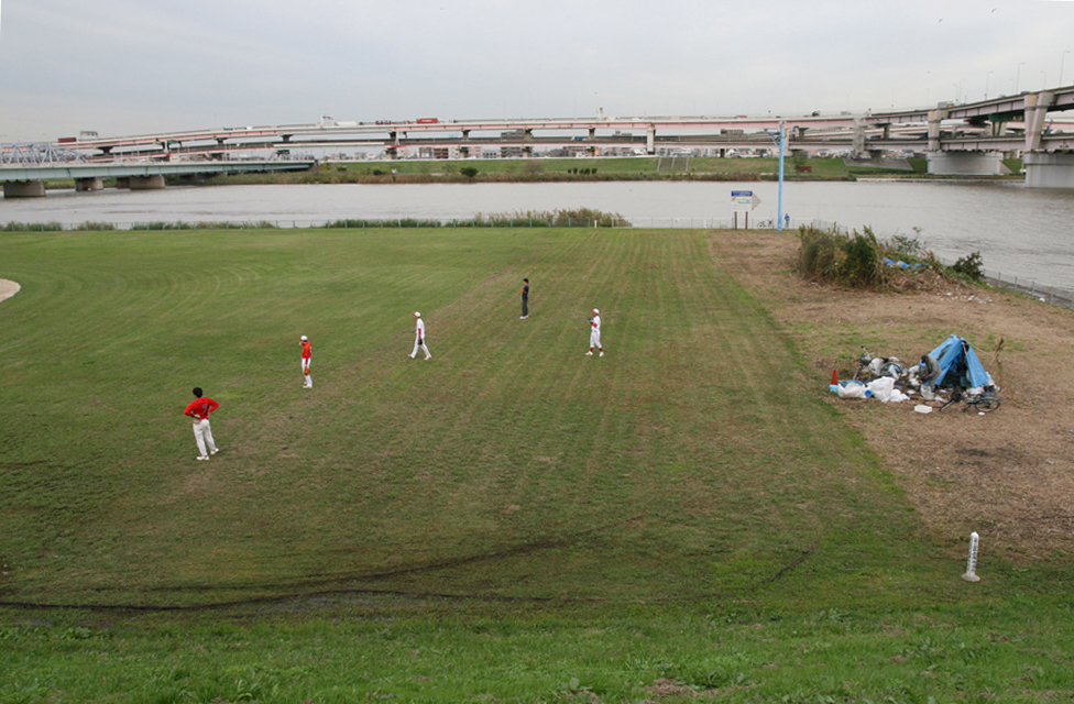 Baseball field and a homeless settlement in evacuation area